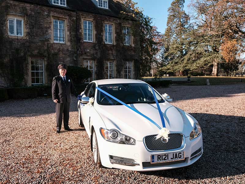 Contact Louis Brunskill from South West Wedding Care Hire - photographed here with the white Jaguar